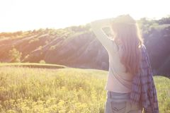 Girl on the nature in sunset time. Freedom - girl on the nature in sunset time Royalty Free Stock Images