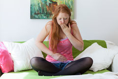 Girl with nausea stock images