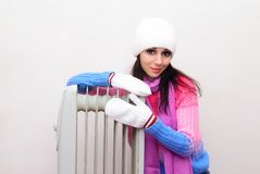 Free Girl  Near A Radiator Heated Royalty Free Stock Image - 159143186