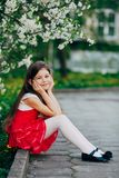 Girl near apple tree flowers in the park Royalty Free Stock Photos