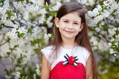 Girl near the apple tree flowers Stock Photos