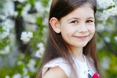 Girl near the apple tree flowers Royalty Free Stock Image