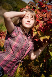 Girl near the ashberry bush shrub Royalty Free Stock Images