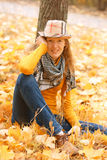 Girl near autumn tree Royalty Free Stock Photography