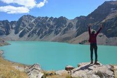 Girl near beautiful mountain lake. Girl, lake, mountains Royalty Free Stock Image
