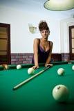 Girl near a billiard table Royalty Free Stock Photos
