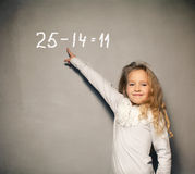Girl near blackboard Royalty Free Stock Image