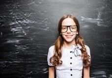 Girl near blackboard Stock Images