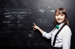 Girl near blackboard Royalty Free Stock Photos