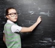 Girl near blackboard Stock Photo