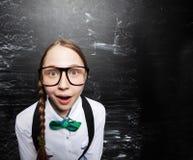 Girl near blackboard Stock Photos