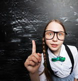 Girl near blackboard Stock Image