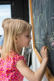 Girl near the blackboard Royalty Free Stock Photos