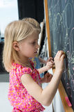 Girl near the blackboard Stock Photo