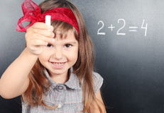 Girl Near Blackboard Showing Chalk Stock Photos