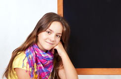 Girl near blackboard with space for text Royalty Free Stock Photography