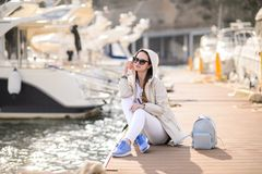 Beautiful girl outdoors. Spring day. The girl near boats on a marina stock photos