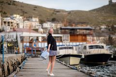 Beautiful girl outdoors. Spring day. The girl near boats on a marina stock images