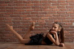 Girl near brick wall Royalty Free Stock Photos