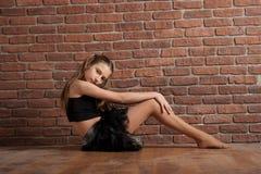 Girl near brick wall Stock Image