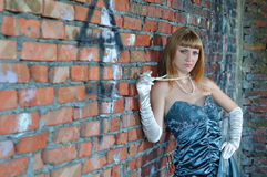 The girl near a brick wall Stock Images