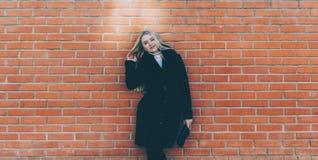 Girl Near The Brick Wall royalty free stock photos
