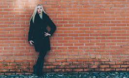 Girl Near The Brick Wall royalty free stock photo