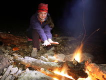 Girl near campfire Stock Photography