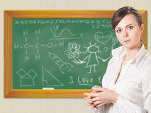 Girl near chalkboard Stock Image