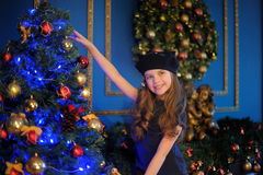 Girl  near christmas decorated tree Stock Photos
