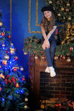 Girl  near christmas decorated tree Stock Photography