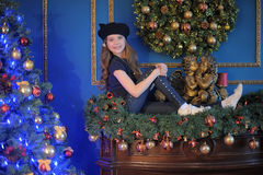 Girl  near christmas decorated tree Stock Image