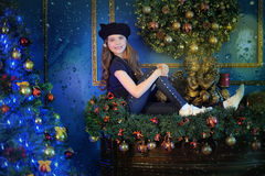 Girl  near christmas decorated tree Stock Images