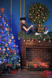 Girl  near christmas decorated tree Royalty Free Stock Photos