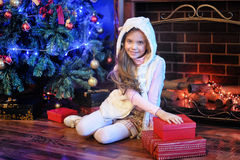 Girl  near christmas decorated tree Royalty Free Stock Photo