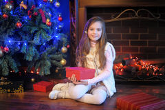 Girl  near christmas decorated tree Stock Photo