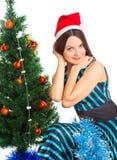 Girl near Christmas fir tree Royalty Free Stock Image