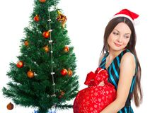 Girl near Christmas fir tree Stock Photography
