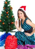 Girl near Christmas fir tree Stock Image