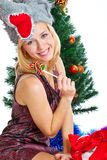 Girl near Christmas fir tree Royalty Free Stock Photography