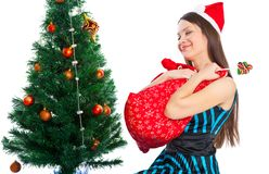 Girl near Christmas fir tree Royalty Free Stock Photography