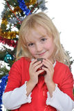 Girl near Christmas fir-tree Royalty Free Stock Images