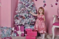 Girl near Christmas fir-tree Stock Images