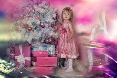 Girl near Christmas fir-tree Royalty Free Stock Photos