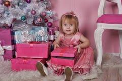 Girl near Christmas fir-tree Stock Image