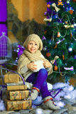 The girl near a Christmas fir-tree 2 Royalty Free Stock Image