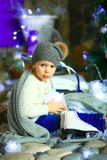 The girl near a Christmas fir-tree Royalty Free Stock Image