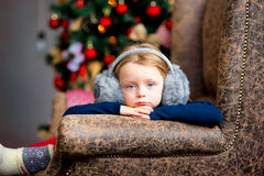 The girl near a Christmas fir-tree in red tones Royalty Free Stock Photography