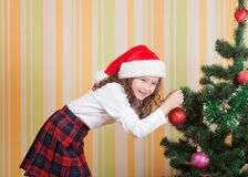 Girl near christmas tree Royalty Free Stock Photo
