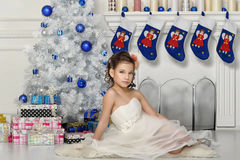 Girl  near a Christmas tree Royalty Free Stock Photography